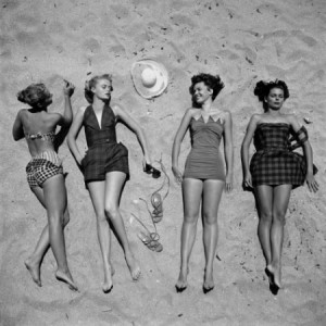 nina-leen-four-models-showing-off-the-latest-bathing-suit-fashions-while-lying-on-a-sandy-florida-beach_i-G-37-3795-SJIIF00Z-e1340564344146