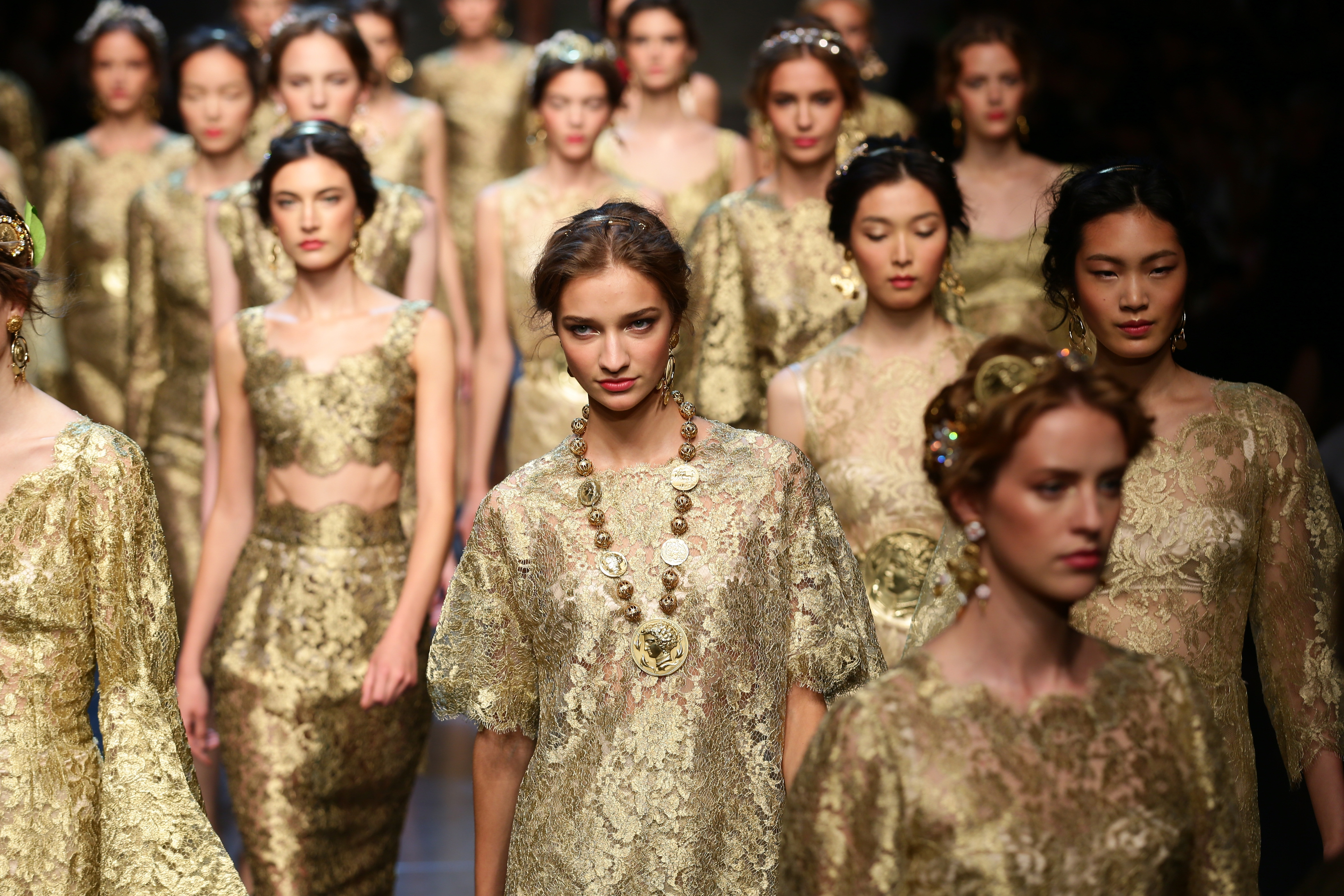 MILAN, ITALY - SEPTEMBER 22:  Models walk the runway during the Dolce & Gabbana show as part of Milan Fashion Week Womenswear Spring/Summer 2014 on September 22, 2013 in Milan, Italy.  (Photo by Vittorio Zunino Celotto/Getty Images)